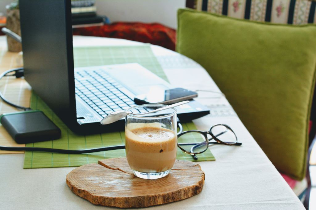 Photo by Djurdjica Boskovic on Unsplash. Working from home. Coffee and computer - that's me!